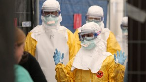 Volunteers for Medecins Sans Frontieres receive training on how to handle personal protective equipment during courses in Brussels